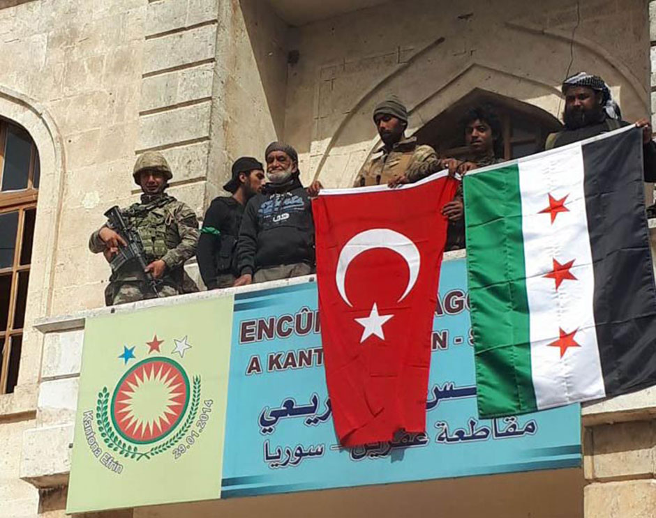 297c0f7c0b9 Turkish soldier and Free Syrian Army members display Turkish and Syrian  Flags in Afrin town center after Turkish Armed Forces and Free Syrian Army  (FSA) ...
