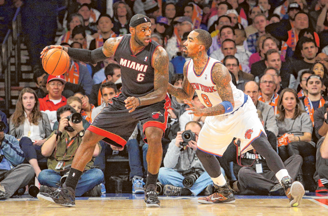 6eb963fe8 Miami Heat small forward LeBron James (left) is defended by New York Knicks  shooting guard J.R. Smith (right). The Heat defeated the Knicks 106-91.