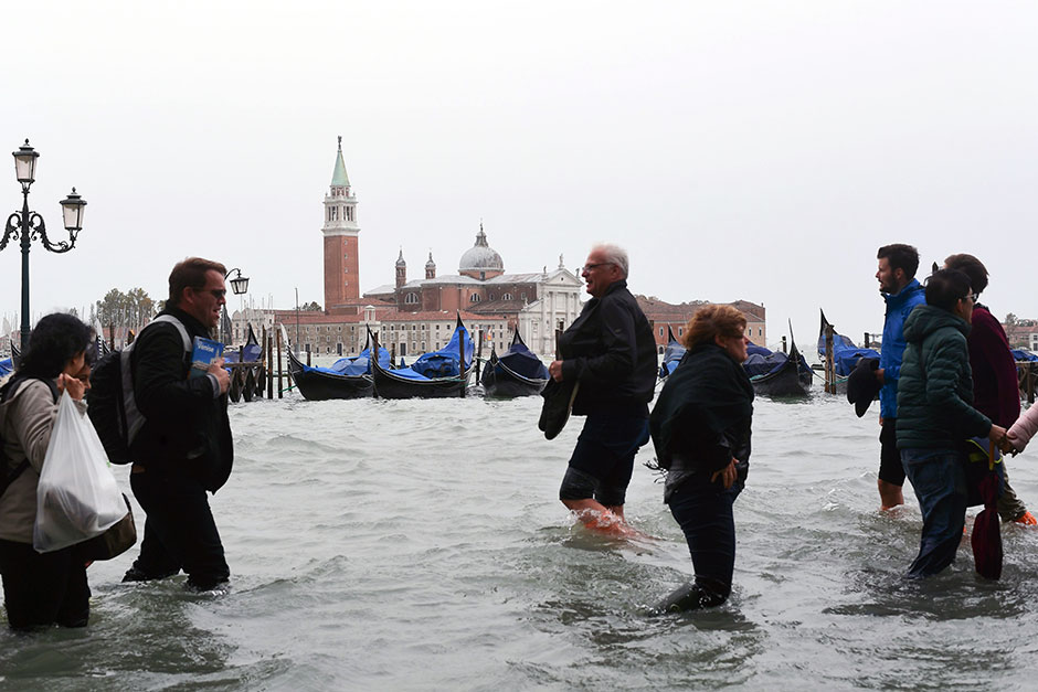 Venice flooded as heavy rain and high winds batter Italy