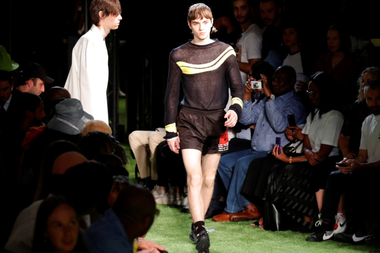 819f024be6d1 A model presents a creation by designer Virgil Abloh as part of his  Spring Summer 2019 collection for Off-white fashion label during Men s  Fashion Week in ...