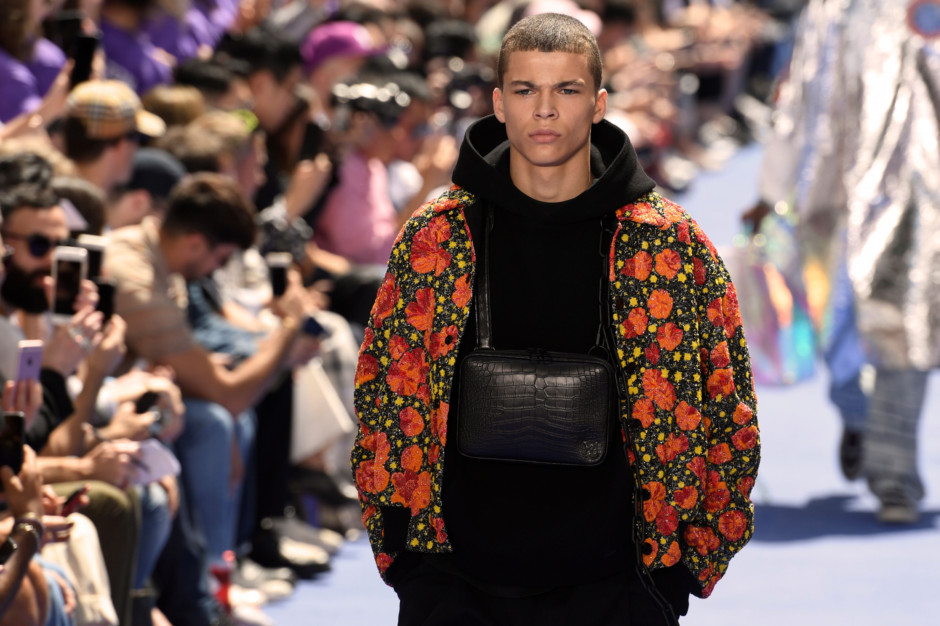 13a36024ef10 A model presents a creation by Louis Vuitton during the men s Spring Summer  2019 collection fashion show on June 21
