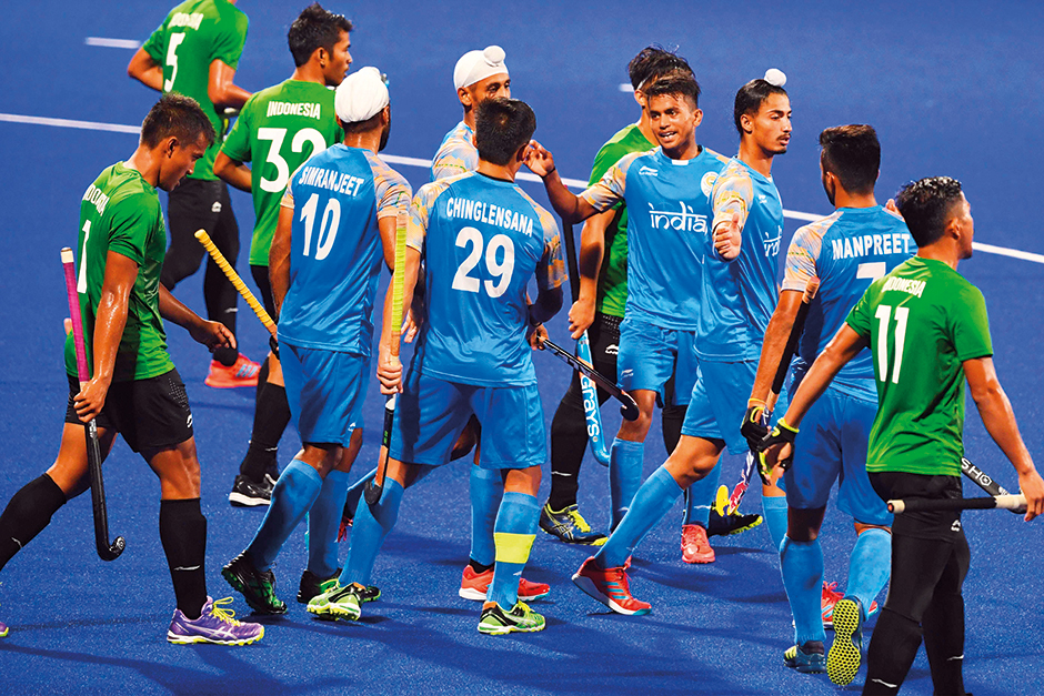5cbd2104953 India s players celebrate after scoring a goal during the men s hockey pool  A match between India and Indonesia at the 2018 Asian Games in Jakarta on  August ...