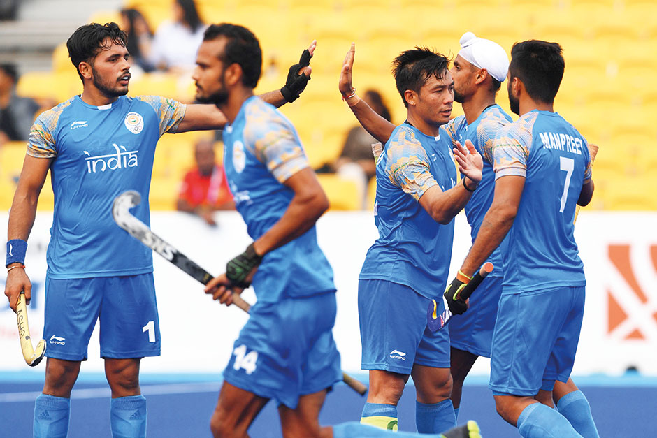 7bbc24ab611 India s players celebrate after scoring a goal during the men s hockey pool  A match between India and Sri Lanka. Image Credit  AFP